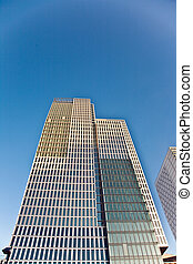 skyscraper in Frankfurt with blue sky and facade in sun