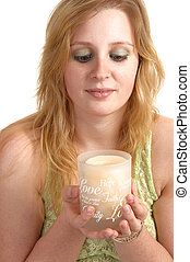 Girl holding candle.