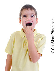 Portrait of a frightened boy isolated on a white background