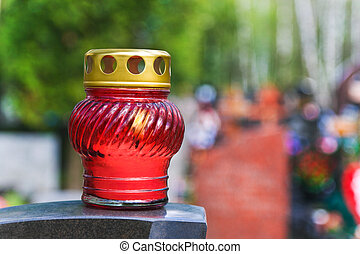 Candle on stone tomb at cemetery - religion background