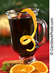 Hot spiced mulled wine garnished with orange peel Selective...