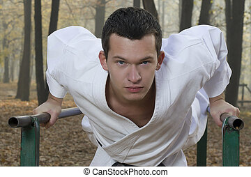 Karate training in autumn forest - Portrait of teacher...