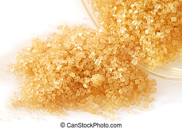 Brown sugar - heap of yellowish brown sugar over white...