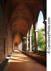 The cloister - A long cloister in a catholic cathedral with...