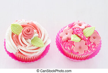 Vanilla cupcakes with flower decorations
