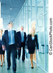 Business enthusiasts - Enthusiastic business team following...