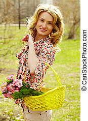 Girl with basket - Girl holding a basket with flowers and...