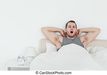 Man yawning while waking up
