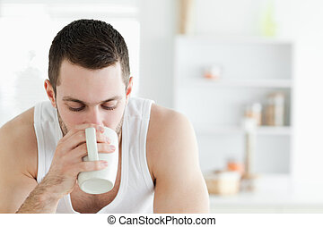 Close up of a man having coffee