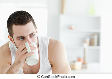 Close up of a young man having coffee