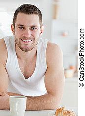 Portrait of a man having breakfast