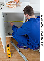 Portrait of a repair man measuring something