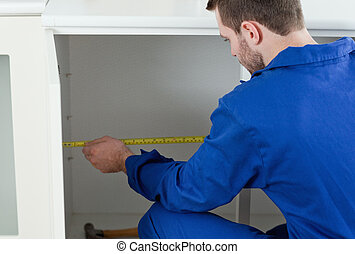 Handyman measuring something