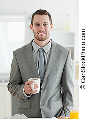 Portrait of a businessman having breakfast