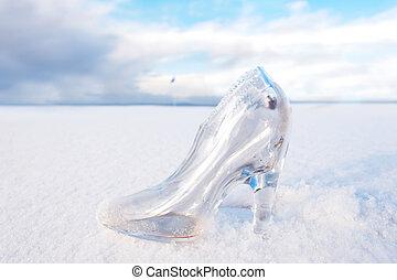 glass slipper on snow covered links golf fairway