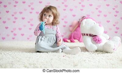 Happy baby girl on the floor lookin