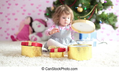 Baby girl is preparing a Christmas  - Childhood