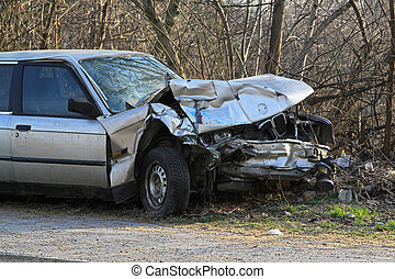 Car wreck - Crushed car in front collision traffic accident