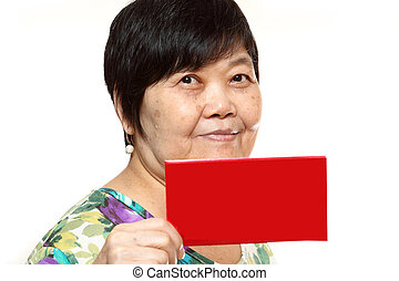 Asian woman holding a red card
