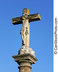 cross in blue sky - an ancient catholic cross in blue sky