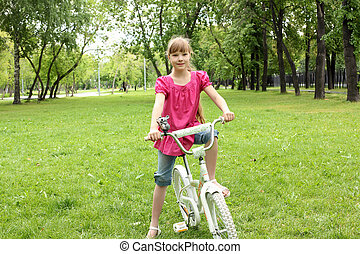 Girl with a bike in the park