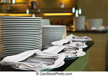 Catering service - place setting - plate, knife and fork on...