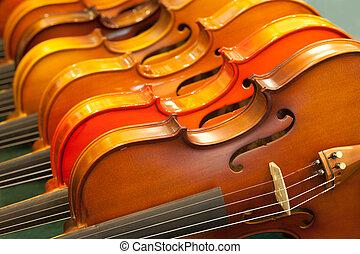 cierre, Arriba,  violín