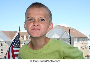 Angry Boy Outdoors - Boy leaning toward camera with an angry...