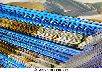 Brochures - Bunch of commercial brochures. Shallow, spotted...