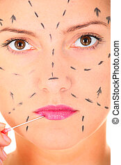 Plastic surgery - A close-up of female face and a needle...