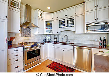 White new luxury kitchen with modern new appliances.