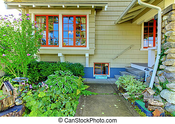 Covered front porch of the old craftsman style home.