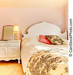 Pink bedroom with white bed and nightstand - Charming pink...