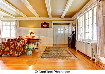 Living room with golden and white and entrance door,