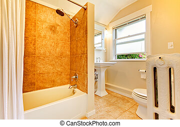 Newly remodeled bathroom with window and gold tiles. - Fresh...