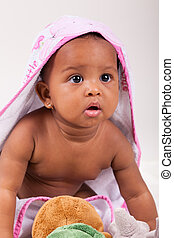 Adorable little african american baby girl looking