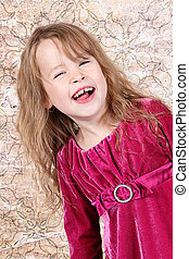 Little Girl Laughing with her christmas dress on