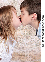 boy and girl kissing each other - closeup