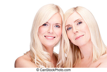 mother and daughter- natural beauty, over white