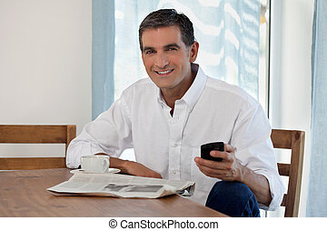 Middle Aged Man Holding Cell Phone - Man Reading Morning...