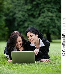 Female Executives Using Laptop