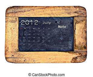 Calendar 2012, July on Old small blackboard isolate on white...