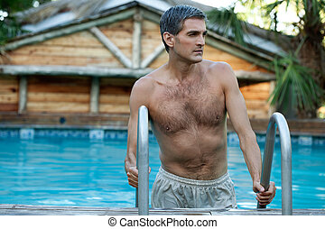 Man Coming Out of the Swimming Pool - Handsome man coming...