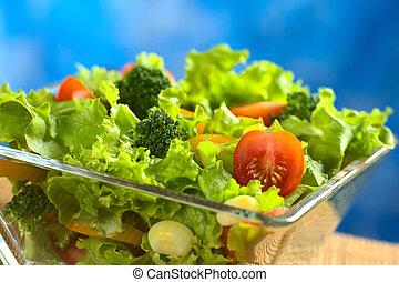 Fresh vegetable salad made of tomato, broccoli, corn, yellow...