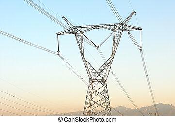 High voltage transmission lines with blue sky as background