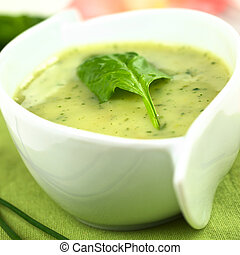 Spinach cream soup with fresh spinach leaf on top Selective...