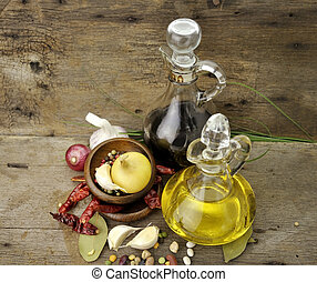 Cooking Oil Vinegar And Spices On Wooden Background