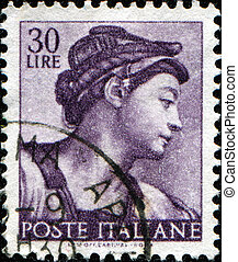 fresco by Michelangelo - ITALY - CIRCA 1961: A stamp printed...