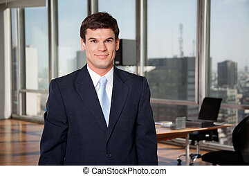 Male Entrepreneur Smiling - Portrait of smart well-dressed...
