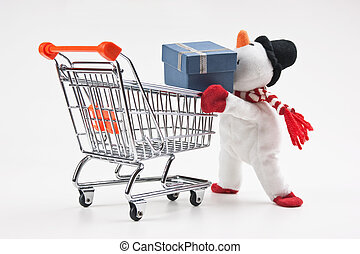 toy snowman and shopping cart on white background